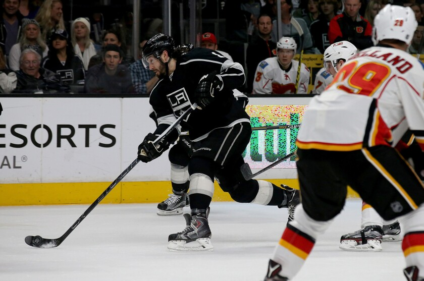 Kings defenseman Drew Doughty takes a shot on goal against the Flames in the first period.