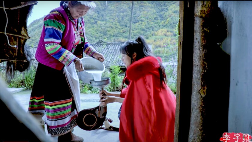 Screenshot from a video of Li Ziqi (right) collecting mare's milk for kumis, a fermented drink. Li Ziqi, who documents life in rural China, is one of the most watched food bloggers in the world.