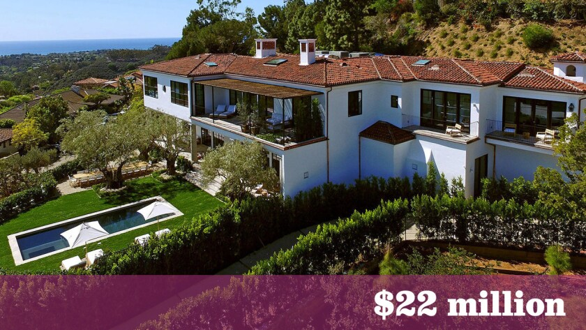 The 12,000-square-foot spec house built on the site of Ronald and Nancy Reagan's onetime home in Pacific Palisades has sold for $22 million.