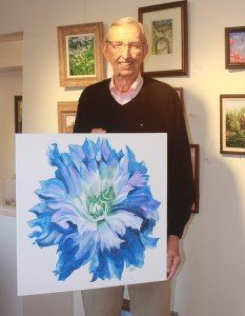 George Johnson with the blue dahlia painting he is submitting for the upcoming annual fundraiser.  Photos by Ashley Mackin