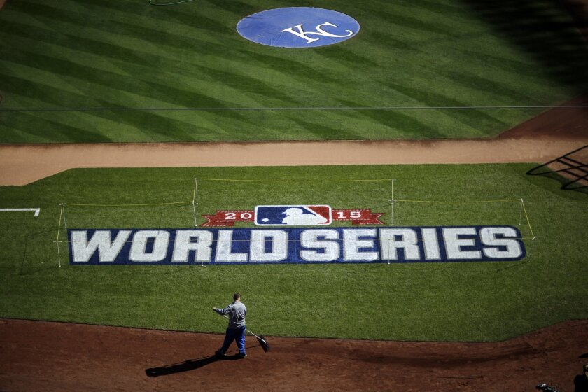 A worker gets Kauffman Stadium ready before media day for the Major League Baseball World Series between the New York Mets and the Kansas City Royals Monday, Oct. 26, 2015, in Kansas City, Mo. (AP Photo/David Goldman)