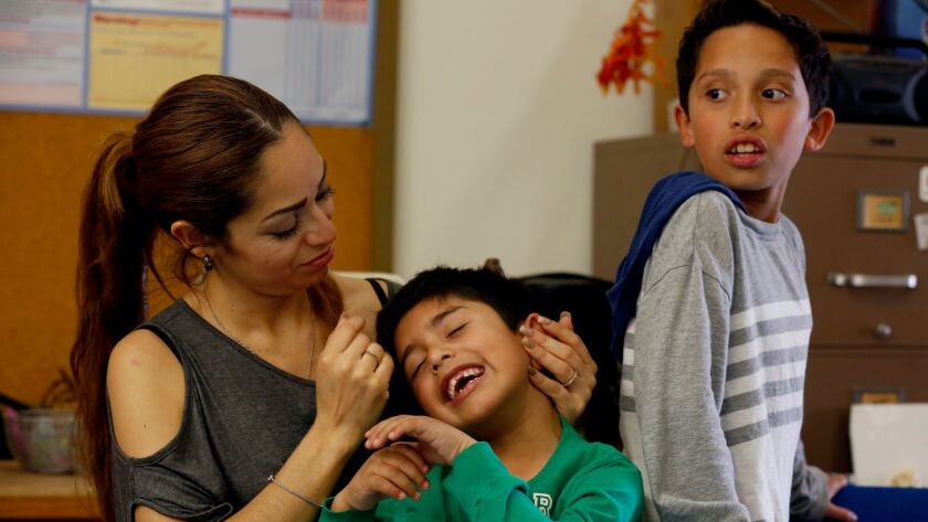 Liliana Sanchez de Saldivar, shown last week with her sons Jesus, 6, and Pablo, 10, lived at a Simi Valley church for three years to avoid deportation. (Francine Orr / Los Angeles Times)