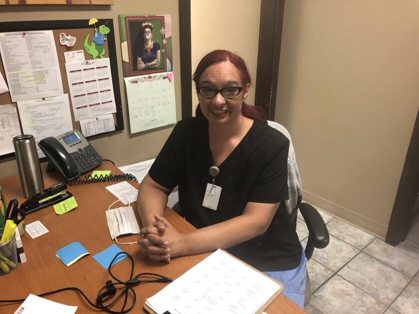 Melissa Tovar sits an office desk