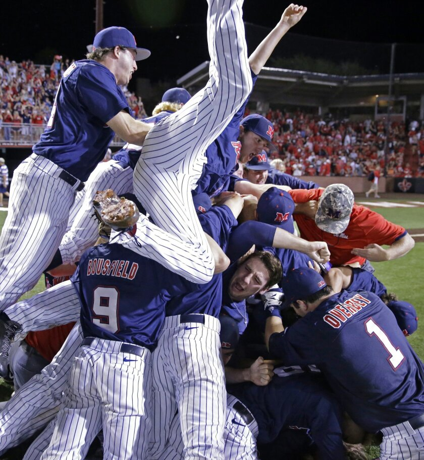 Mississippi celebrates their victory over Louisiana Lafayette during an NCAA college baseball tournament super regional game in Lafayette, La.,Monday, June 9, 2014. Mississippi won 10-4 to advance to the College World Series. (AP Photo/Gerald Herbert)