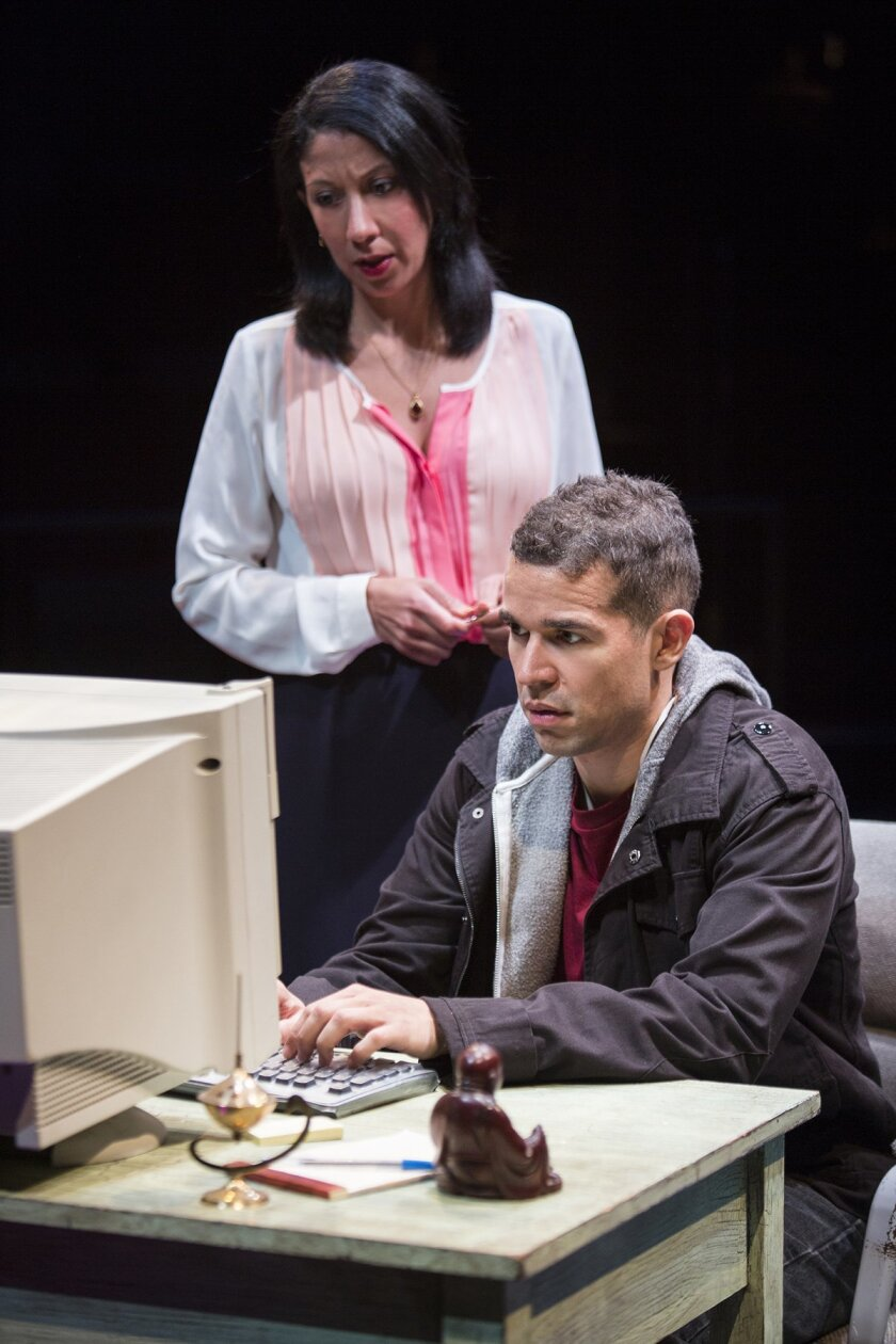 Yazmin (Sarah Nina Hayon) and her nephew, Elliot, (Rey Lucas) get reacquainted after his military service in 'Water by the Spoonful,' directed by Edward Torres at The Old Globe Theatre.  Jim Cox