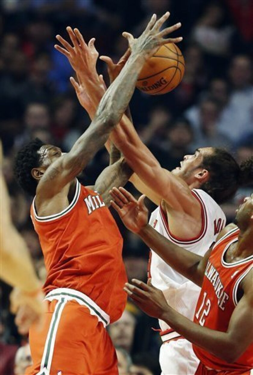 Milwaukee Bucks forward Larry Sanders, left, and Chicago Bulls center Joakim Noah battle for a rebound during the first half of an NBA basketball game in Chicago, Wednesday, Jan. 9, 2013. (AP Photo/Nam Y. Huh)