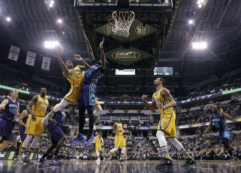 Indiana Pacers' Myles Turner (33) puts up a shot against Charlotte Hornets' Michael Kidd-Gilchrist (14) during the first half of an NBA basketball game Wednesday, Feb. 10, 2016, in Indianapolis. (AP Photo/Darron Cummings)