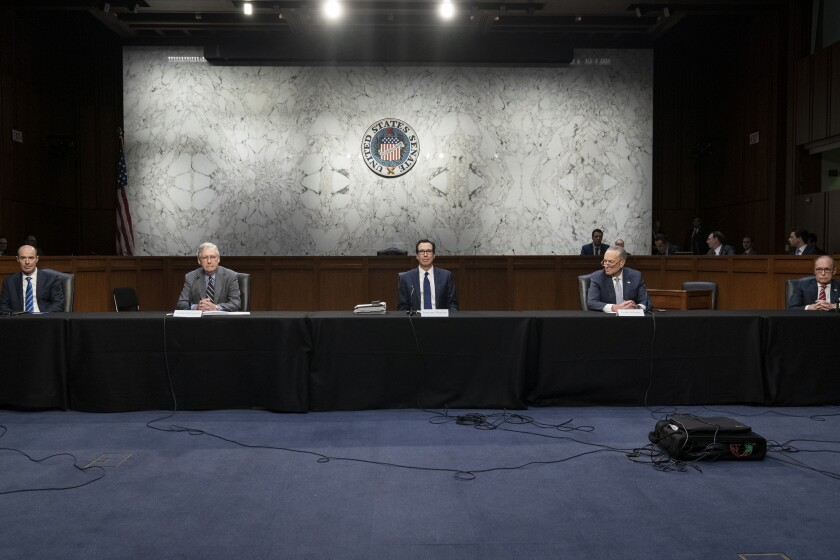 Socially distanced, Labor Secretary Eugene Scalia, left, Senate Majority Leader Mitch McConnell (R-Ky.), Treasury Secretary Steven T. Mnuchin, Senate Minority Leader Charles E. Schumer (D-N.Y.) and National Economic Council Director Larry Kudlow attend a negotiation session about a next-step economic bailout on Friday.