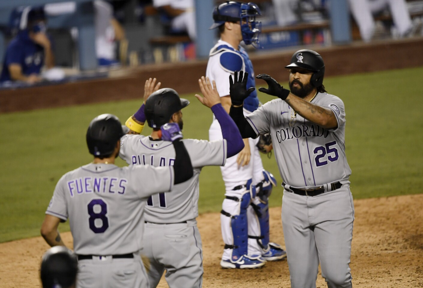 LOS ANGELES, CA - SEPTEMBER 06: Matt Kemp #25 of the Colorado Rockies celebrates his two home run with Kevin Pillar #11 and Josh Fuentes #8 against relief pitcher Caleb Ferguson #64 of the Los Angeles Dodgers during the eight inning at Dodger Stadium on September 6, 2020 in Los Angeles, California. Pillar scored on Kemp's home run. (Photo by Kevork Djansezian/Getty Images)