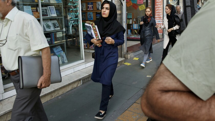 A woman shops for textbooks in downtown Tehran. More than 60% of university students in Iran are female, according to official statistics.