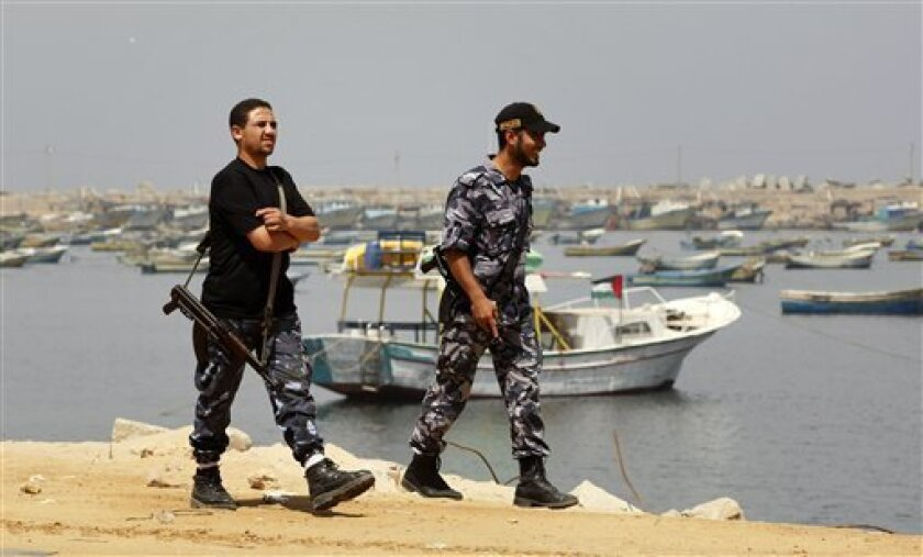 Hamas security officers patrol on Gaza's seaport, Tuesday, June 1, 2010. Palestinians in Gaza declared a general strike and a day of wrath following Israel's deadly naval raid on an aid flotilla bound for the blockaded Gaza Strip on Monday. (AP Photo/Hatem Moussa)