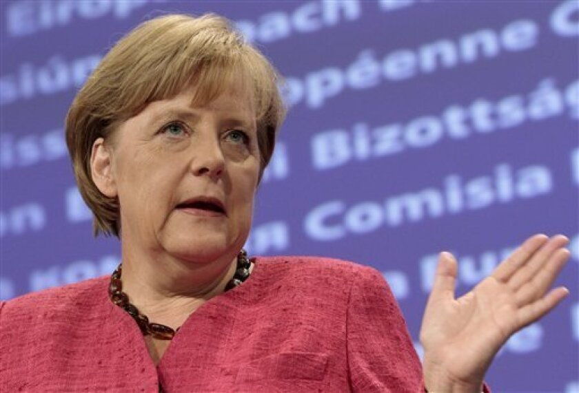 German Chancellor Angela Merkel speaks during a news conference at the European Commission headquarters in Brussels, Wednesday, Oct. 5, 2011. Germany's chancellor said Wednesday that she would support a Europe-wide plan to recapitalize banks if such a move was deemed necessary. (AP Photo/Yves Logghe)