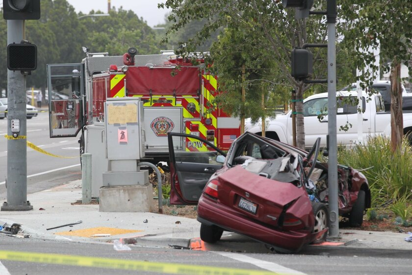 In this file photo, a Honda Accord came to rest on the southeast corner after colliding with the fire truck on the sidewalk to the east at the intersection of Poway and Midland roads on June 20. Honda passenger Evelyn Courtney, 19, was killed. On Thursday, deputies arrested the Honda driver, Robbie Gillespie, on suspicion of vehicular manslaughter and driving while impaired during the crash.