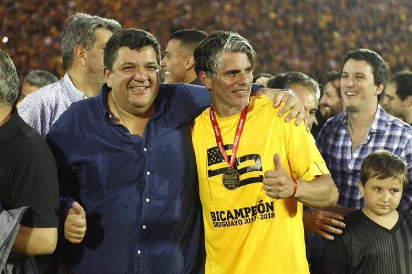 Peñarol club president Jorge Barrera (L) and coach, Diego Lopez celebrate after their team won the Uruguayan title by defeating Nacional 2-1 at Centenario stadium in Montevideo, on Sunday, Nov. 11. EFE-EPA/Federico Anfitti