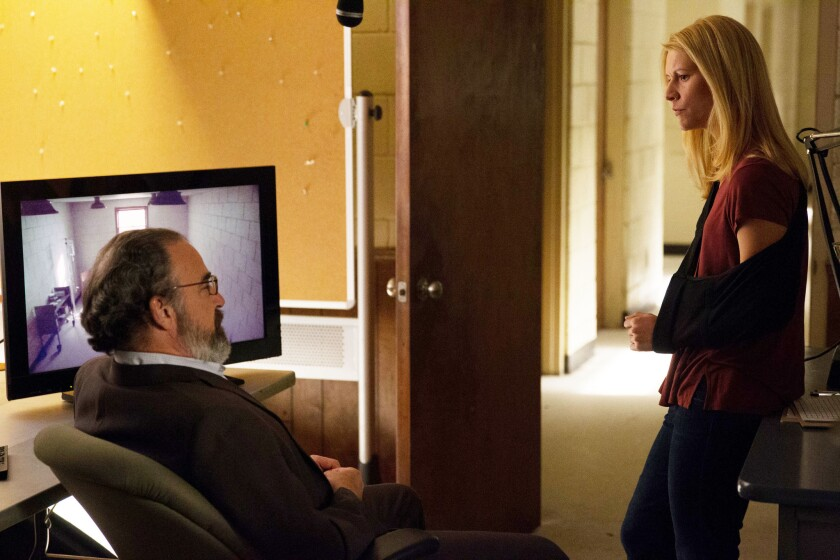 CIA Acting Director Saul Berenson (Mandy Patinkin) tries to regain the support of wounded case officer Carrie Mathison (Claire Danes) on 'Homeland.'