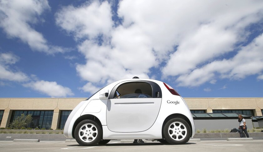 Google's self-driving prototype car in May. The search giant and Ford Motor Co. are in talks about partnering for a new self-driving car, a report says.