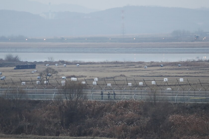 South Korean army soldiers patrol along the barbed-wire fence in Paju, South Korea, near the border with North Korea on Dec. 16, 2019.