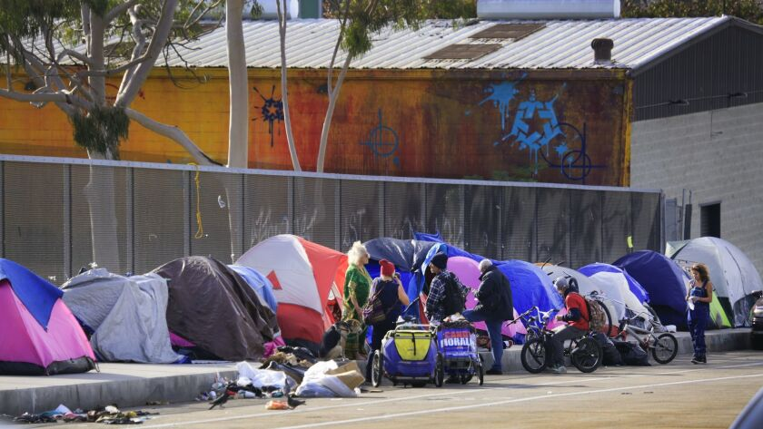 Tents of homeless people line the Island Avenue overpass sidewalk over Interstate 5.