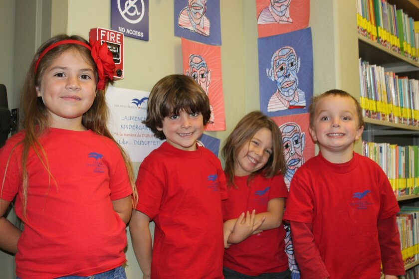 Talissa Porteau de la Morandier, 5, Andre Guizar, 5, Gabriella Price, 5, and Chase Brennan, 4, in front of the work their class made.