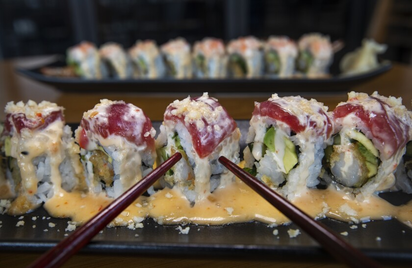 On the menu at Shimaichi Sushi in Kailua-Kona, Hawaii, are the Dragonfly roll, front,  and the Thai Stick roll.