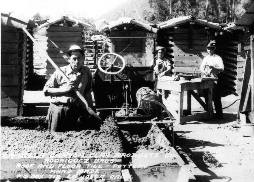 Pug mill run by a Model T-Ford, where the back wheel had been removed and a chain drove on an auger which forced the clay down through, resulting in workable material. In the picture, the Rodriguez brothers