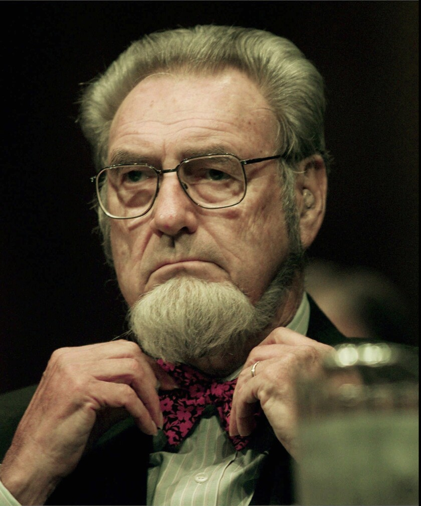 Former Surgeon General C. Everett Koop adjusts his bow tie before the start of the Committee on Agriculture hearing Sept. 11, 1997, at the Capitol. Koop attended the hearing to examine the implications of the proposed tobacco settlement.