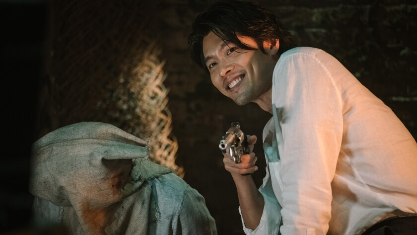 (Left) HYUN Bin as MIN Tae-gu, a notorious arms dealer wanted by the police in the new Korean crime