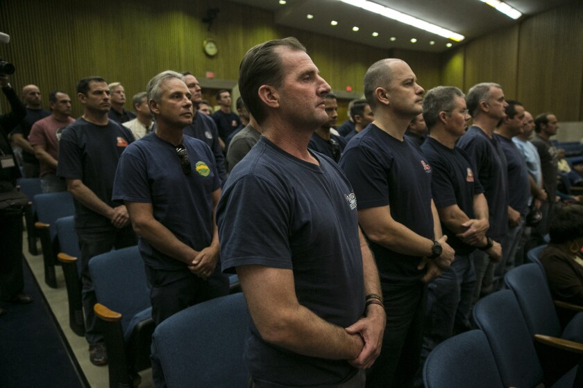 Los Angeles County firefighter Tim Brun joins dozens of others protesting the continued development and construction of cell towers by the Los Angeles Regional Interoperable Communications System.