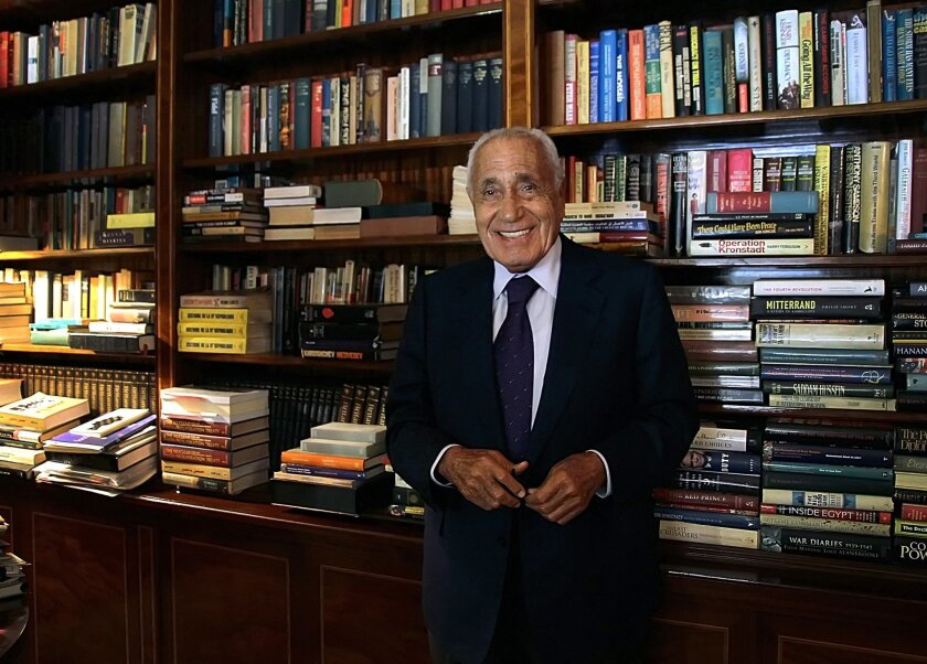In this Sept. 23, 2014 photo, Mohamed Heikal poses for a picture on his 91st birthday, at his office, in Cairo, Egypt. Egypt's state TV has announced the death of one of the country's most prolific political authors and insiders, Mohamed Heikal. He was 92. Heikal, who recently suffered kidney probl