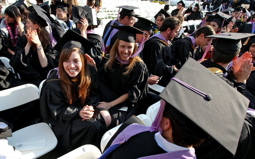 Maria Gomez, 26, left, graduates from UCLA with her master's degree in architecture.