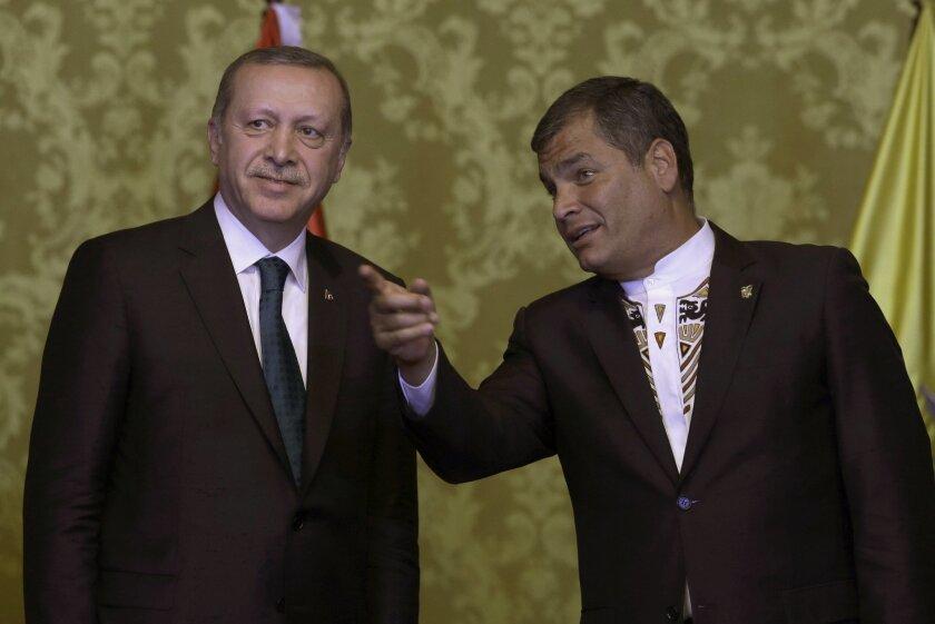 Ecuador's President Rafael Correa, right, talks with Turkey's President Recep Tayyip Erdogan as they meet in Quito, Ecuador, Thursday, Feb. 4, 2016. Erdogan is in Ecuador as part of his Latin America tour that also includes Chile and Peru. (AP Photo/Dolores Ochoa)