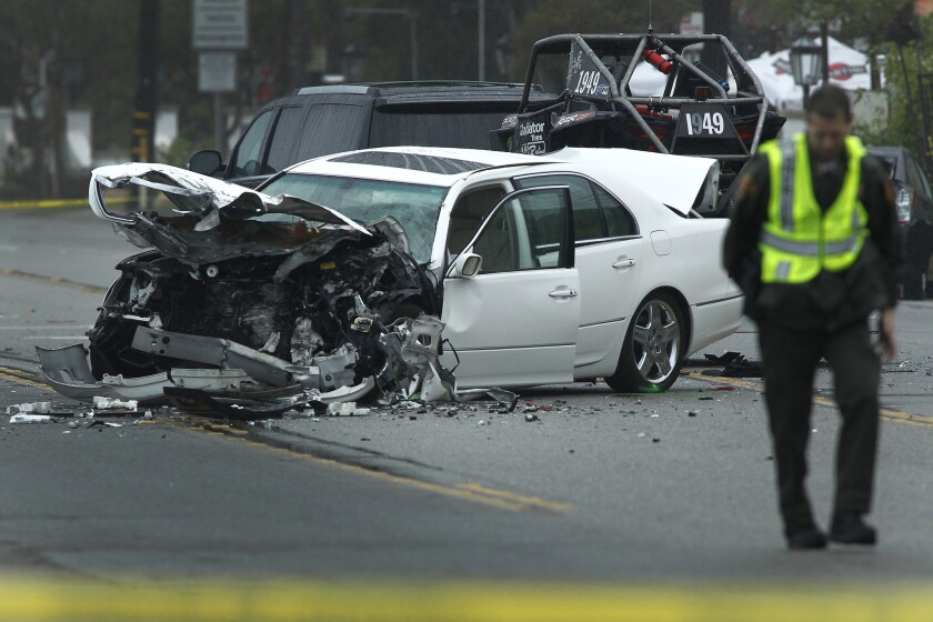 Los Angeles County Sheriff's deputies investigate the scene of a four-vehicle crash in Malibu on Saturday. Officials have confirmed that former Olympian Bruce Jenner was involved in the crash.