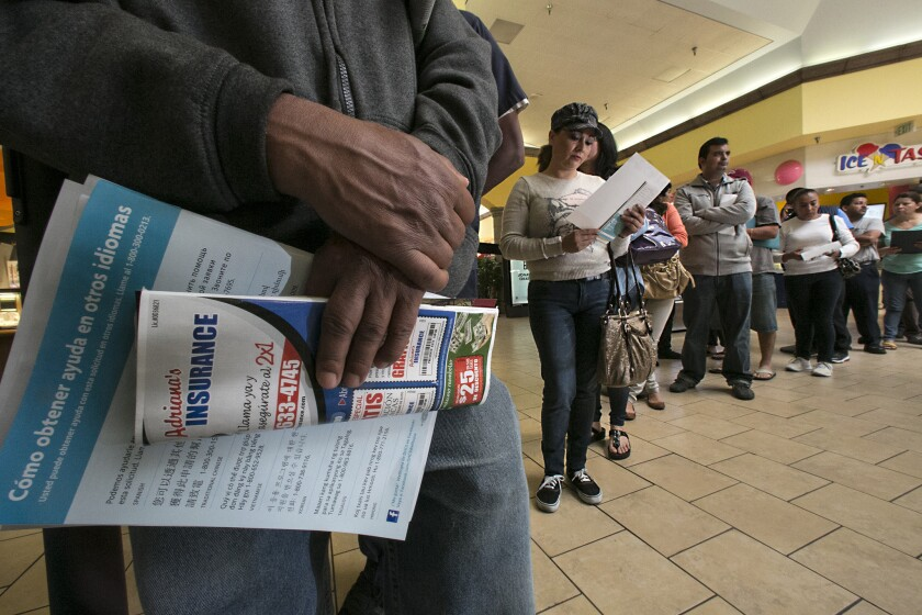 Applicants stand in line at Panorama Mall in Panorama City to sign-up for Covered California at an enrollment event Friday.
