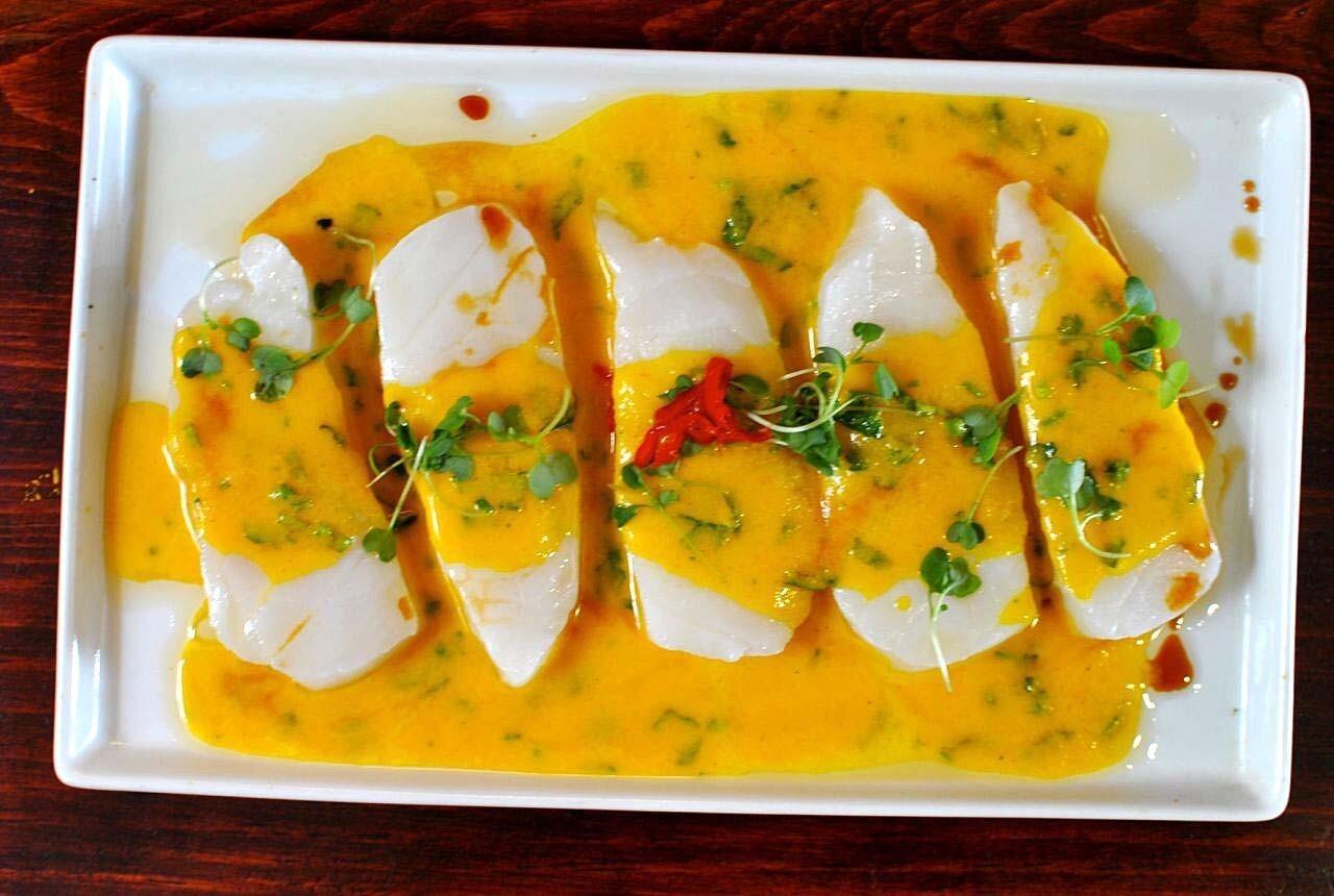 Tiradito de seabass: Seared cuts of seabass in a garlicky aji sauce.