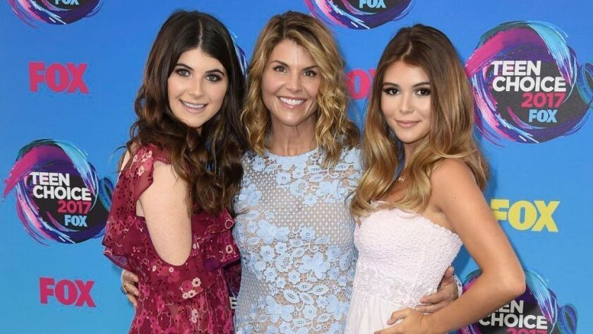 Actress Lori Loughlin, center, with her daughters Bella, left, and Olivia Jade at the Teen Choice Awards in Los Angeles.