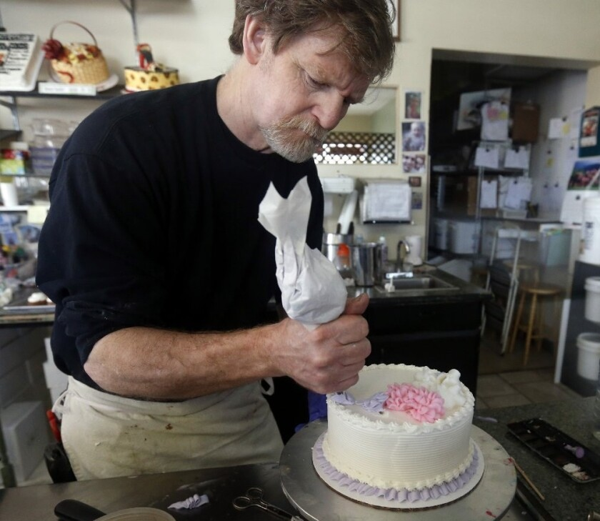 Masterpiece Cakeshop owner Jack Phillips decorates a cake inside his store in Lakewood, Colo.