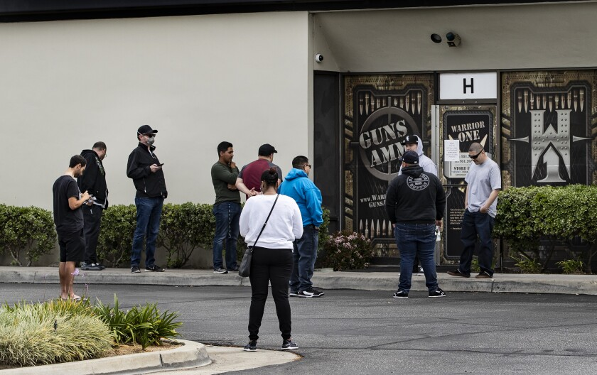 Customers wait in line to buy guns at Riverside's Warrior One Guns and Ammo