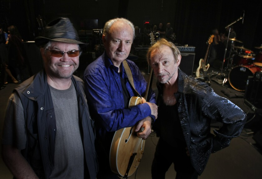 The Monkees surviving members, Micky Dolenz, from left, Michael Nesmith and Peter Tork, pose together in 2012.