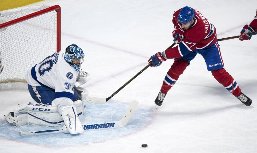Tampa Bay Lightning goalie Ben Bishop makes a save on Montreal Canadiens' Alex Galchenyuk during the first period of an NHL hockey game, Tuesday, Feb. 9, 2016, in Montreal.  (Paul Chiasson/The Canadian Press via AP) MANDATORY CREDIT
