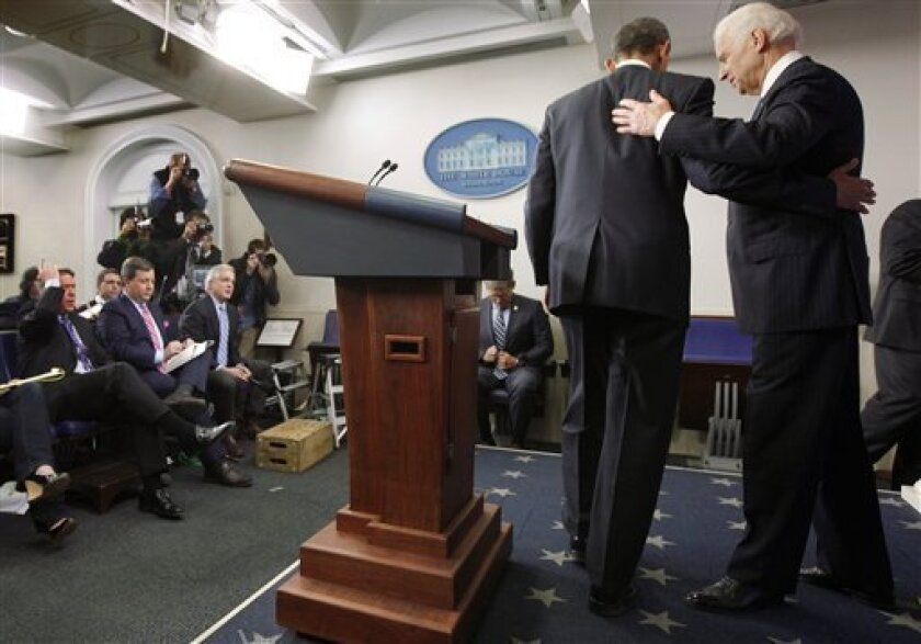 President Barack Obama and Vice President Joe Biden leave the podium after Obama made a statement regarding the passage of the fiscal cliff bill in the Brady Press Briefing Room at the White House in Washington, Tuesday, Jan. 1, 2013. (AP Photo/Charles Dharapak)