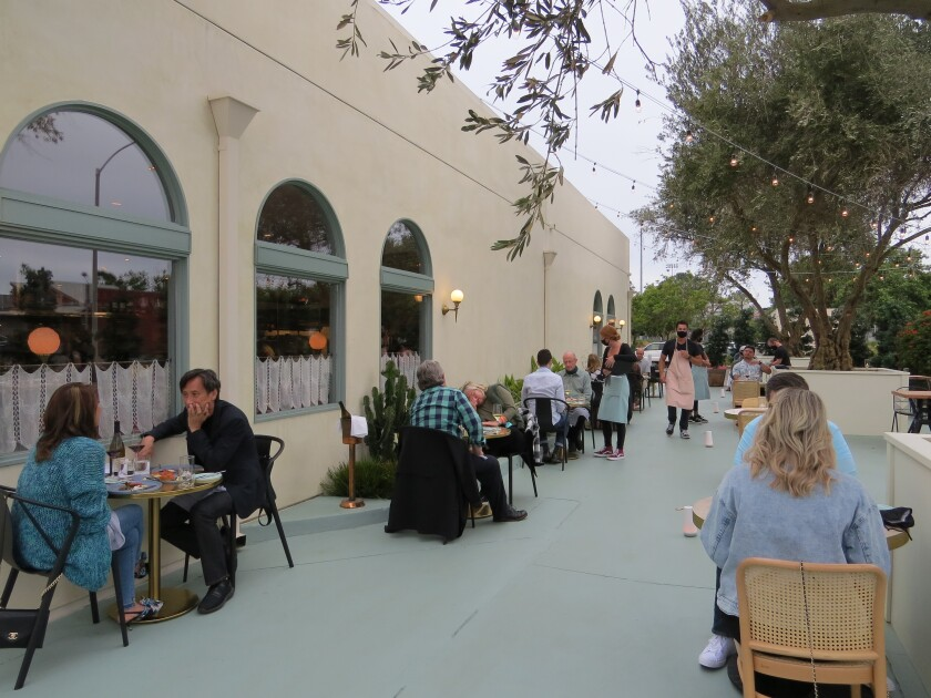 Diners sit at socially distanced tables at newly opened Jeune et Jolie: Starry Night on June 23.