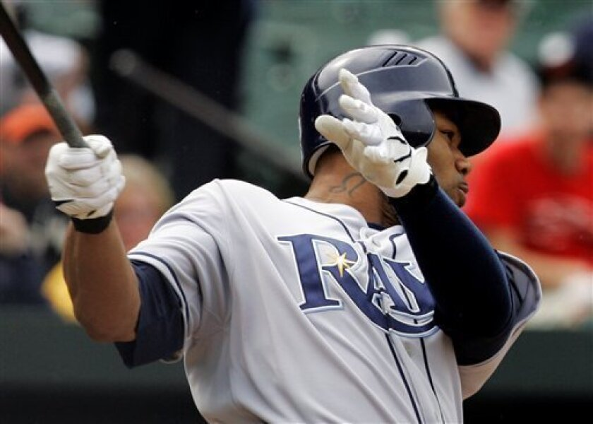 Tampa Bay Rays' Carl Crawford follows through with two-RBI single against the Baltimore Orioles during the seventh inning of a baseball game, Thursday, May 1, 2008, in Baltimore. The Rays won 4-2. (AP Photo/Rob Carr)