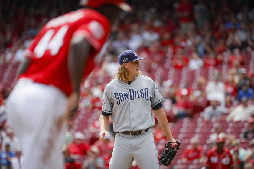 Padres reliever Trey Wingenter reacts after giving up a run on his second bases-loaded walk in the third inning of Wednesday's loss to the Cincinnati Reds.