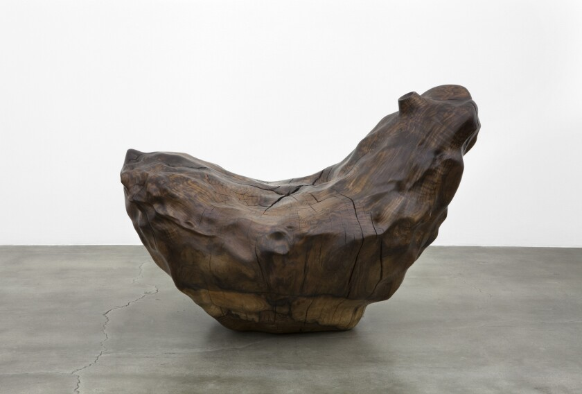 A claro walnut carving by Alma Allen