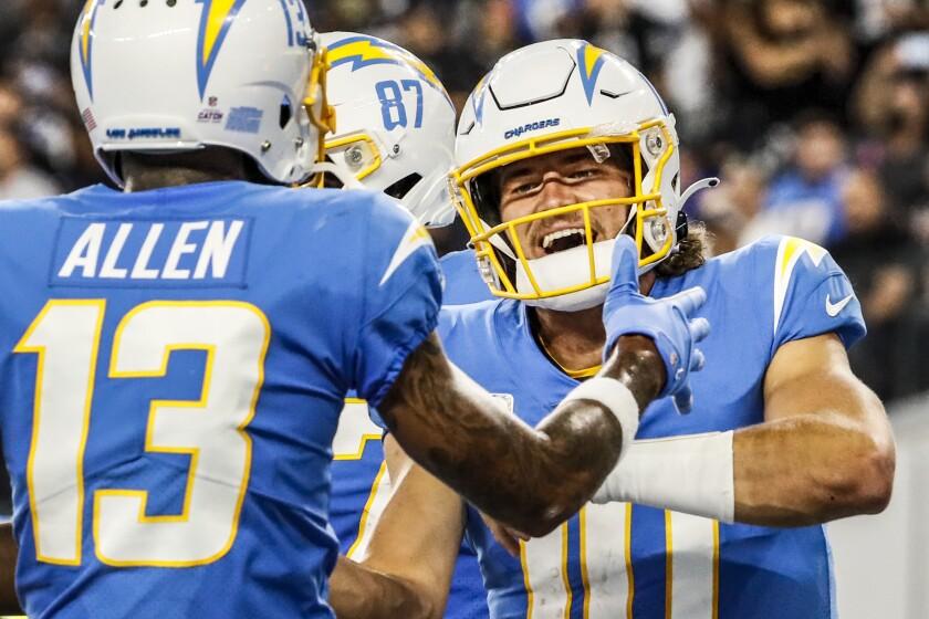 Chargers quarterback Justin Herbert (10) and receiver Keenan Allen celebrate a touchdown.