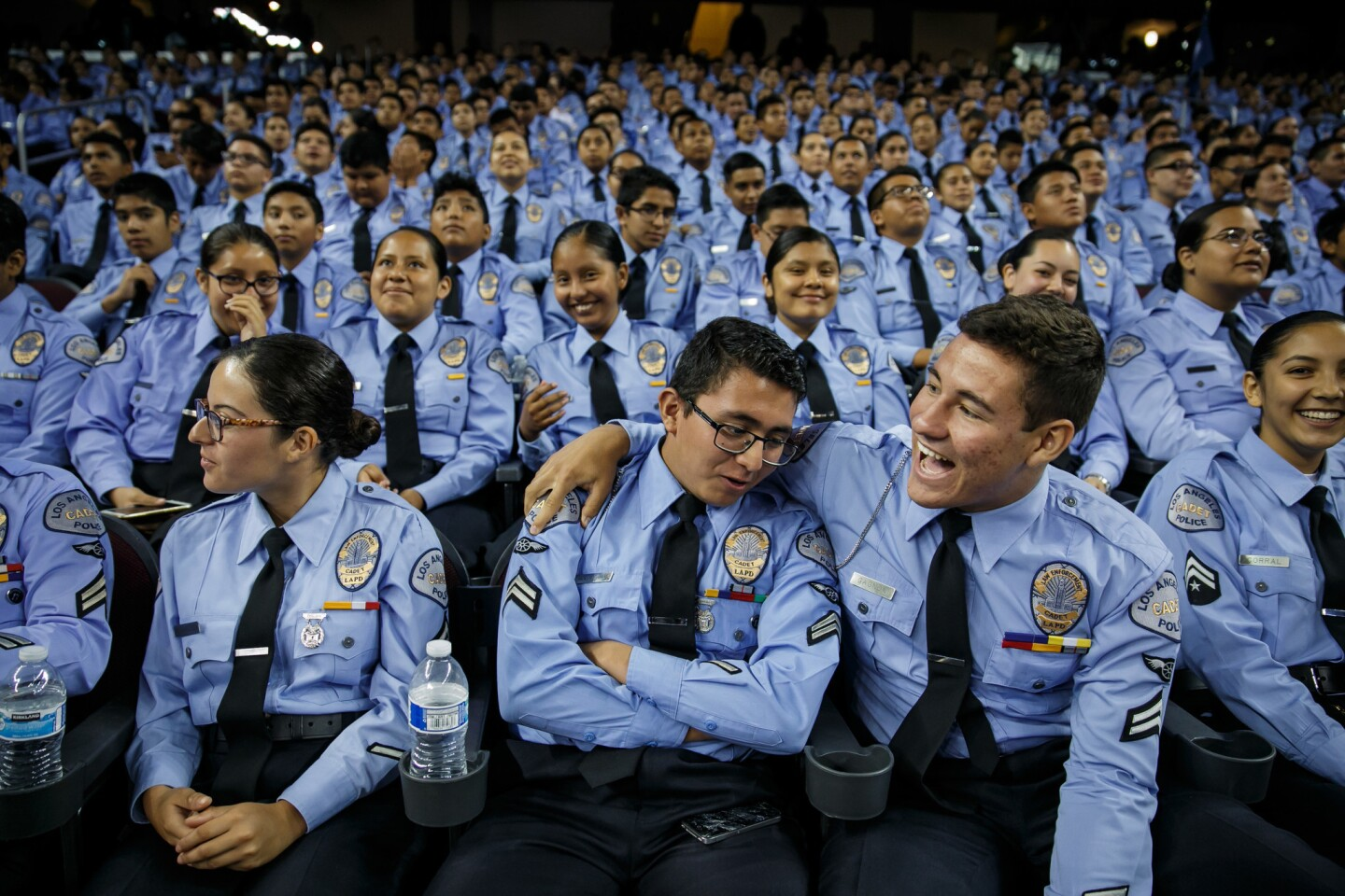 New LAPD cadets enjoy themselves at a graduation ceremony at USC's Galen Center on Saturday.