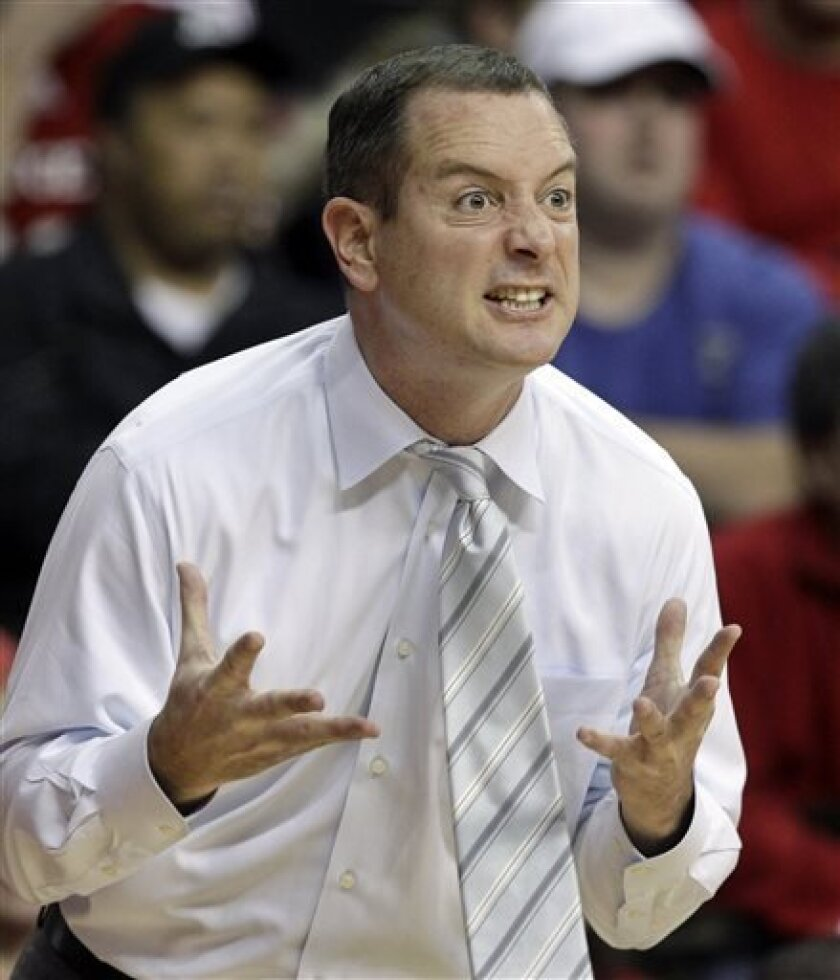 FILE - In this Jan. 7, 2012, file photo, Rutgers coach Mike Rice reacts to play during an NCAA college basketball game against Connecticut in Piscataway, N.J. The airing Tuesday, April 2, 2013, of a videotape of Rice using gay slurs, shoving and grabbing his players and throwing balls at them in practice over the past three seasons has Rutgers athletic director Tim Pernetti reconsidering his decision not to fire the coach. Pernetti was given a copy of the video in late November by a disgruntled