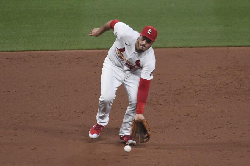 St. Louis Cardinals third baseman Nolan Arenado fields a ground ball by Pittsburgh Pirates' Jacob Stallings during the third inning of a baseball game Friday, June 25, 2021, in St. Louis. (AP Photo/Joe Puetz)