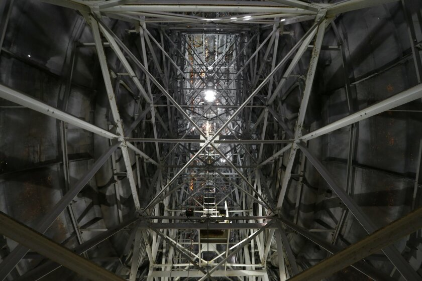 Metal beams line the inside of the Giant Uniroyal Tire in Allen Park, Mich., Wednesday, May 20, 2015. The 80-foot-high, 12-ton tire is turning 50 and has stood alongside Interstate 94, near Detroit, since 1965, a year after it debuted at the New York World's Fair. (AP Photo/Paul Sancya)