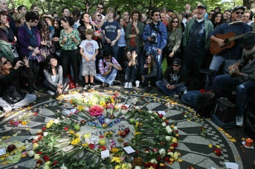 People sing as they gather around the Imagine mosaic in Strawberry Fields in New York's Central Park, Saturday, Oct. 9, 2010, the day that would have been John Lennon's 70th birthday. (AP Photo/Tina Fineberg)